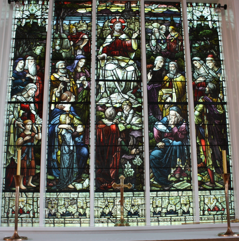 Meredith Windows, behind the altar in the chapel, present St Matthew's